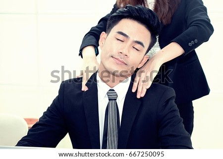 Massaging man at his shoulder