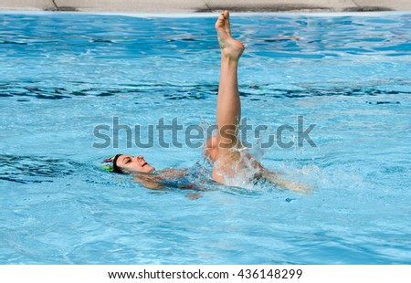 Massagno, Switzerland - 12 June 2016 - Girl in a pool practicing synchronized swimming