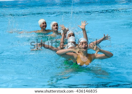 Massagno, Switzerland - 12 June 2016 - group of girls in a pool practicing synchronized swimming