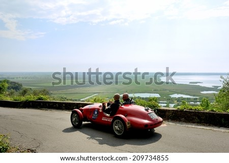 MASSAROSA, ITALY - APRIL 26: A red Fiat Gilco 1100 Sport takes part to the GP Terre di Canossa classic car race on April 26, 2014 near Massarosa. The car was built in 1948. - stock photo
