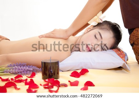Masseur doing back massage on beautiful asian woman body in the spa salon., Beauty treatment concept., Isolated on white background.
