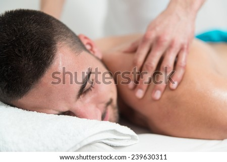 Masseur Doing Massage On Man Body In The Spa Salon - stock photo