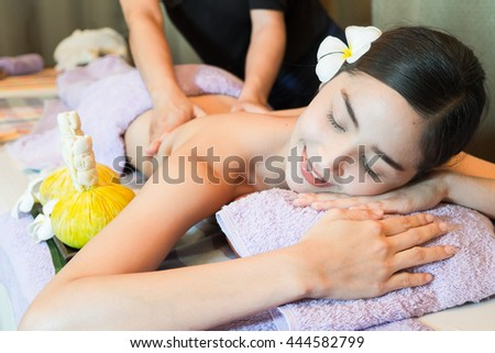Masseur doing massage on woman body in the spa salon. Beauty treatment concept. Thailand.selective focus - stock photo