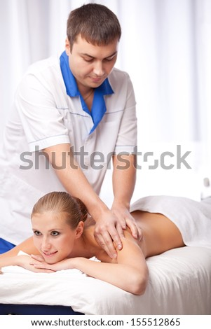 Masseur is massaging female