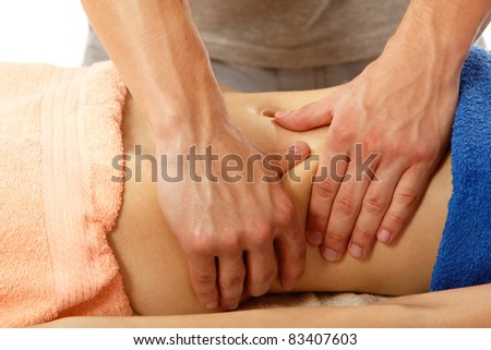 masseur makes belly massage young woman isolated on white background