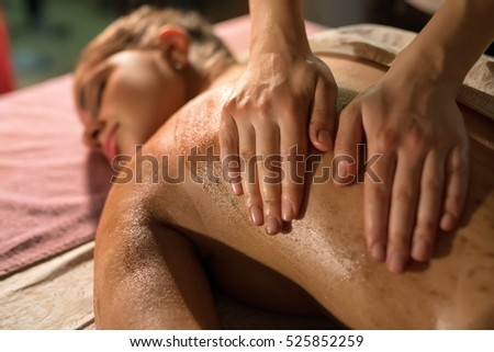 Masseur massaging girl's body. Close-up of hands