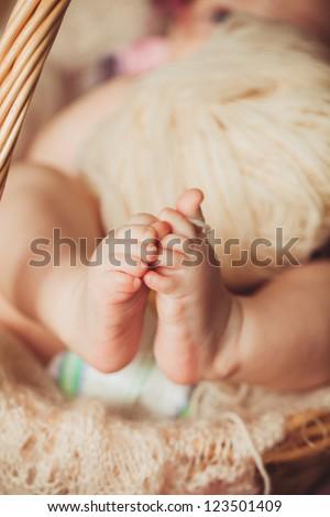 Masseur massaging little baby's foot, shallow focus - stock photo