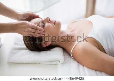 Masseur massaging woman at spa