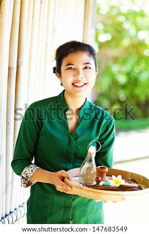 masseuse holding spa ingredients  - stock photo
