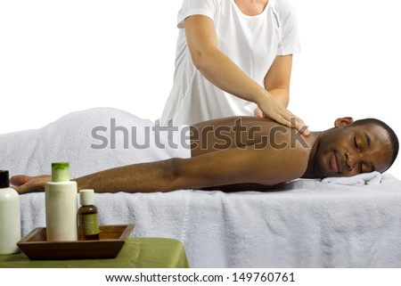 masseuse showing off spa products for men - stock photo