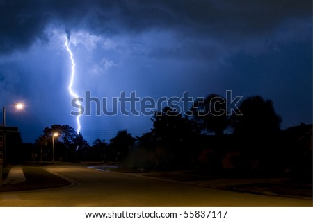 Massive close lightning strike in a column of rain - stock photo