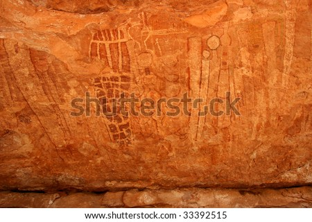 Massive collection of pictographs painted on cave wall by prehistoric Native American(s). Remote part of Grand Canyon National Park, Arizona, USA. Known as Shamans Gallery. - stock photo