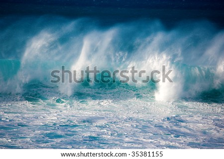 massive crashing wave rolling across the ocean