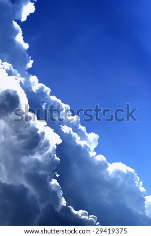 Massive dark clouds in the deep blue sky - stock photo
