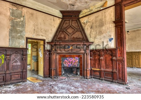 Massive fireplace in an abandoned mansion - stock photo