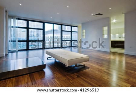 massive living room of a luxury penthouse - stock photo
