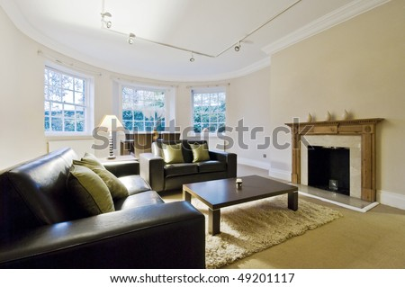 massive living room with bay window and contemporary furniture - stock photo