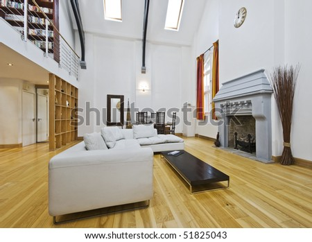 massive living room with double high ceiling and mezzanine - stock photo