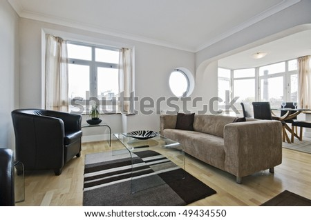 massive modern living room with dining area - stock photo