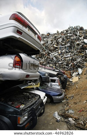 Massive pile of scrap metal and cars to be demolished - stock photo