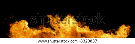 Massive wall of fire and flames on a black background (Huge XXL file) - stock photo