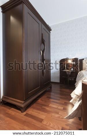 Massive wooden closet in bedroom - stock photo