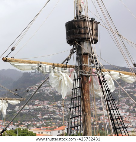 Mast and Rigging of the Santa Maria de Colombo and panorama of Funchal - stock photo