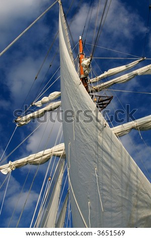 Mast and sail of a tall ship schooner. - stock photo