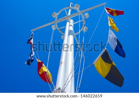 Mast and signal flags tower above the United States Navy Memorial in Washington DC - stock photo