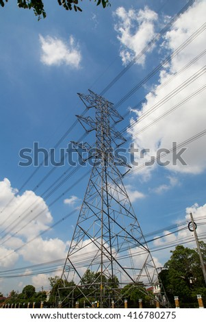 Mast electrical power line against cloud and blue sky. - stock photo