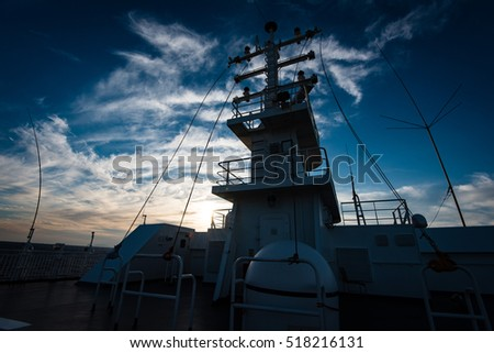 Mast of a greek ferry during sunset