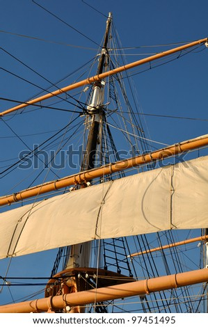 Mast of a Pirate Ship setting off to sea - stock photo