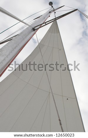 Mast of a yacht on a background of the sky - stock photo