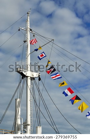 Mast of the ship and maritime signal flags - stock photo