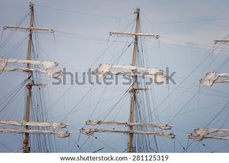Mast sailing ship against a blue sky - stock photo
