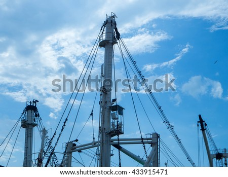 mast spar of ship wire and pole with blue sky background and cloud