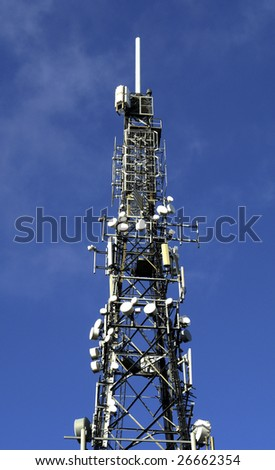 Mast with antennas and dishes for radio, television and cellular / mobile telephone communications.