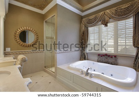 Master bath in elegant home with large tub - stock photo
