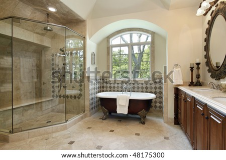 Master bath in luxury home with glass shower - stock photo