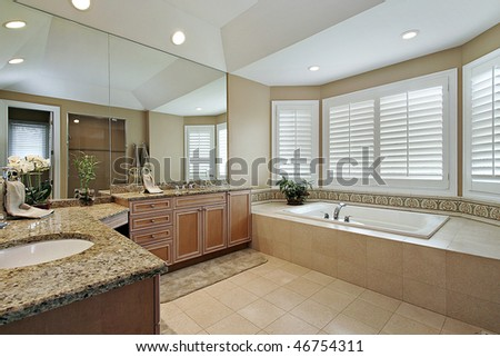 Master bath in luxury home with granite counters - stock photo