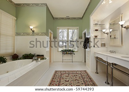 Master bath in luxury home with green walls - stock photo