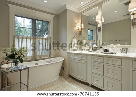 Master bath in luxury home with marble counter - stock photo