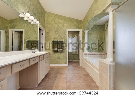 Master bath in luxury home with tub columns - stock photo