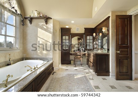 Master bath in new construction home with dark cabinetry - stock photo