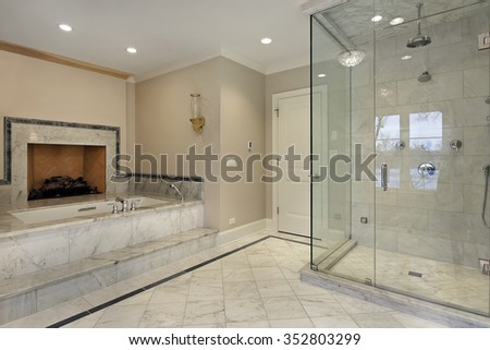 Master bath in new construction home with fireplace - stock photo