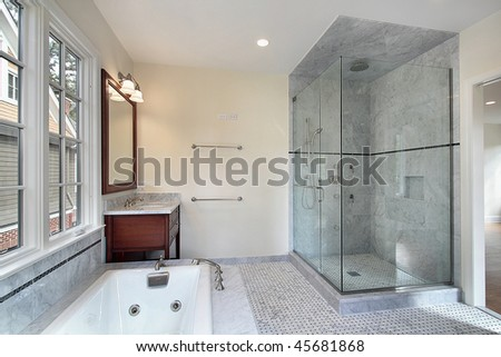 Master bath in new construction home with large glass shower - stock photo