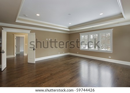 Master bath in new construction home with tray ceiling - stock photo