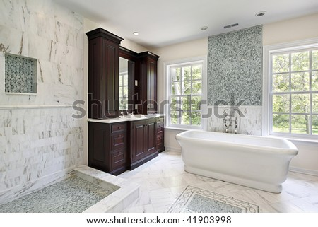 Master bath in new construction home with white tub - stock photo