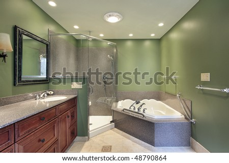 Master bath in suburban home with green walls