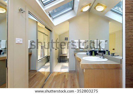Master bath in suburban home with skylights - stock photo